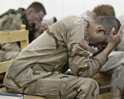 US Army soldiers pray during Christmas church service at military camp in Baghdad